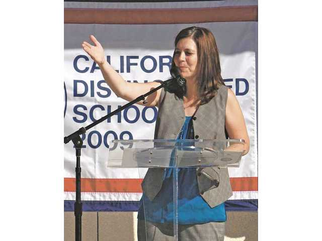 "Rancho Pico Junior High Principal Michele Krantz addresses students and attendees at Thursday morning's ""Distinguished School Celebration."""