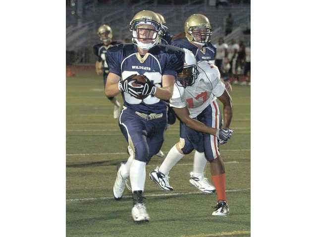 West Ranch High running back Zak Snell (36) runs for a touchdown Friday night at Valencia High against Lancaster.