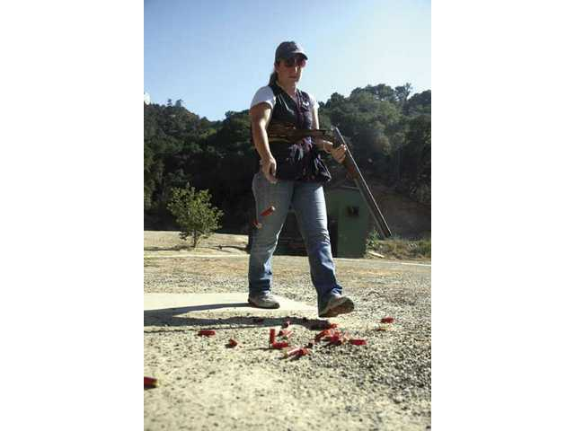 Kim Rhode stands with her shotgun recently at Oak Tree Gun Club in Newhall.