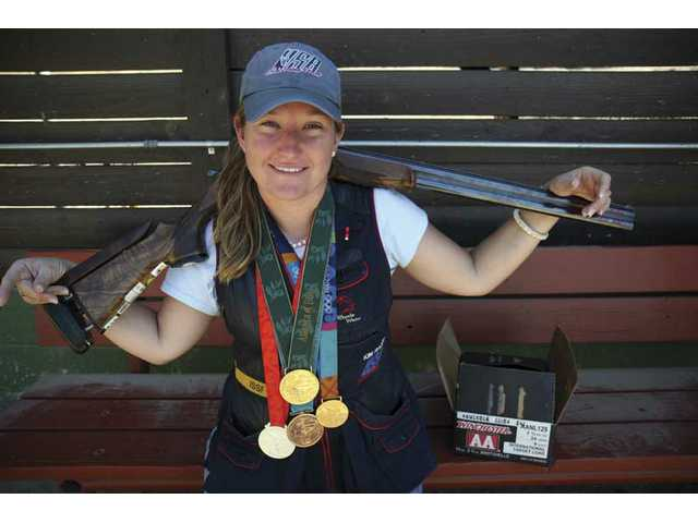 Kim Rhode takes a break from shooting recently at Oak Tree Gun Club in Newhall. The Olympic medal winner received the silver medal on Aug. 14 in Beijing, China, for skeet shooting. In the 1996 Atlanta Games, Rhodes was labeled the youngest female gold medalist in Olympic shooting history.