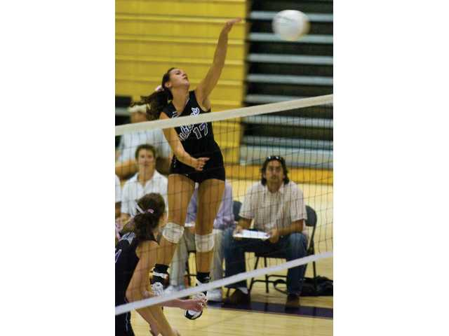 Valencia outside hitter Shelby LeDuff unleases a kill Thursday at Valencia High, in the first game of a match against Dos Pueblos. The Vikings lost in four games.