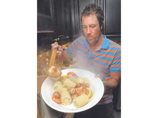 "David Lawrence dishes up his southern-style shrimp boil in his Canyon Country home. His ""Kitchen Rock Star"" class costs $40 per class and includes sampling the meal at the end."