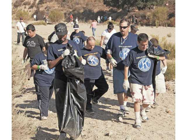 Steve Bratzel, with sunglasses, leads a group of 12 adults cleaning up the Santa Clara riverbed as part of the SCV Action Club, which is sponsored by the Santa Clarita Kiwanis Club. Dozens of community organizations brought out teams of volunteers to support the city of Santa Clarita's 15th annual River Rally.
