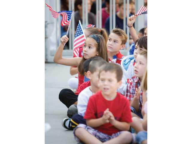 Sulphur Springs Elementary School students show their patriotism by waving American flags and wearing red, white and blue clothing during the school's Constitution Day celebration Friday morning.