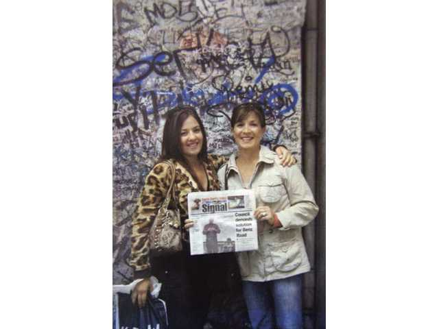 Left to right, Brittnie Grajeda and Jessica Miller stand in front of a piece of the Berlin Wall in Berlin, Germany, in the summer of 2008. Grajeda and Miller took their trip for a family reunion.
