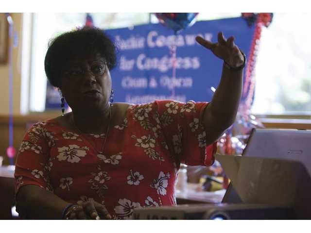 "Minerva Williams, correspondent secretary of the Santa Clarita Valley Democratic Club discusses a slideshow prepared for the Saturday afternoon ""Women and Politics"" event at Coco's restaurant in Stevenson Ranch."