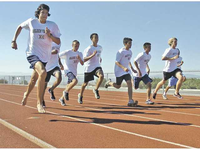 Golden Valley's boys cross country team jogs on the track at Golden Valley High School during cool-down drills Wednesday. The Grizzlies finished 11th in the state last year and return a majority of the runners responsible for the accomplishment.