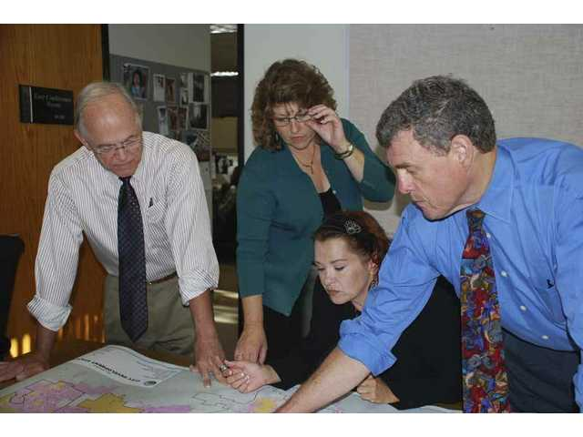 From left: Bill Kennedy, Kathy Norris and Julie Weith from the Valley Industrial Association join Paul Brotzman, director of community development for the city of Santa Clarita, to discuss plans for workforce housing that will be discussed at VIA's Sept. 16 business luncheon. The event will be held in conjunction with the SCV Chamber of Commerce, City of Santa Clarita and Building Industry Association.
