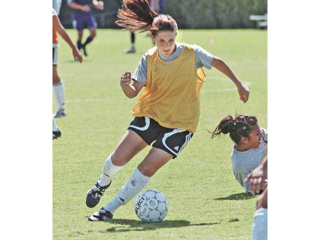 Hart graduate Sarina Coutin dribbles the ball during practice on Thursday. Coutin, the Santa Clarita Valley's all-time prep goal-scoring leader, transferred to COC from Cal-State Bakersfield.