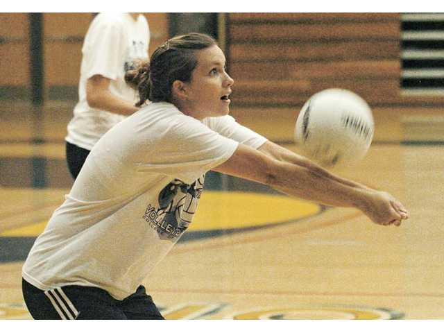 College of the Canyons setter Ashlie Arnold passes the ball at practice Thursday on the COC campus. The Cougars will take part in the difficult San Diego Mesa Tournament this weekend.