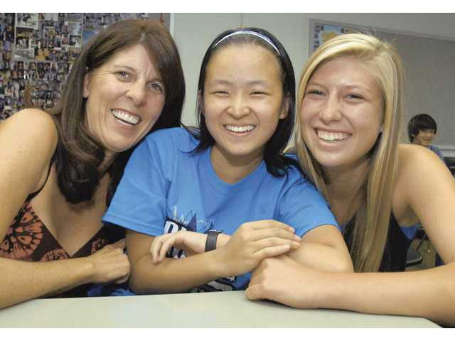 "Host Family members Shari Ane, left, and daughter Keani, 14, right,  pose with Chinese exchange student ""Elizabeth"" Bitian Chen as she visits the United States and studies at Saugus High School for five months."