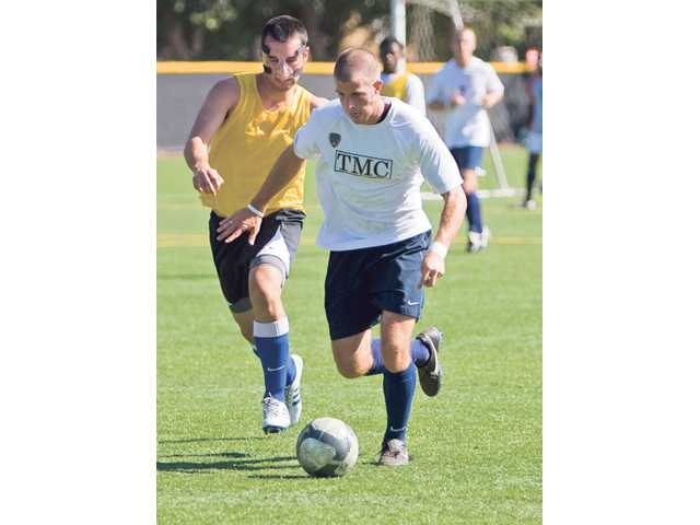 Junior Jacob Marchesani, right, works on dribbling during soccer practice at The Master's College on Thursday afternoon.