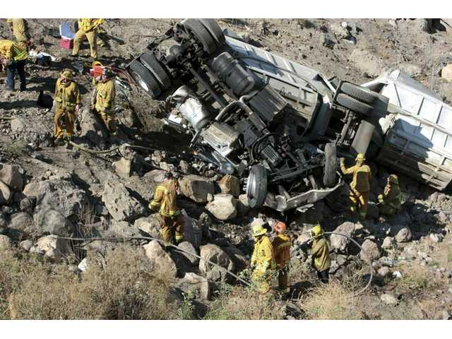The aftermath of a crash Tuesday when a big-rig slammed into a SUV and went off an embankment on Highway 14 in Agua Dulce.
