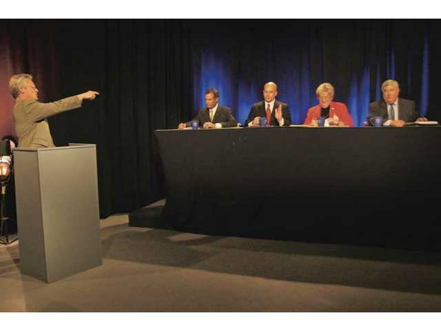 Moderator Leon Worden, left, lays out the rules for the College of the Canyons board candidates before the debate, hosted by SCVTV and The Signal newspaper, begins Wednesday afternoon. Seated, left to right, are Michael Berger, Brian Koegle, Joan MacGregor and Randy Moberg.