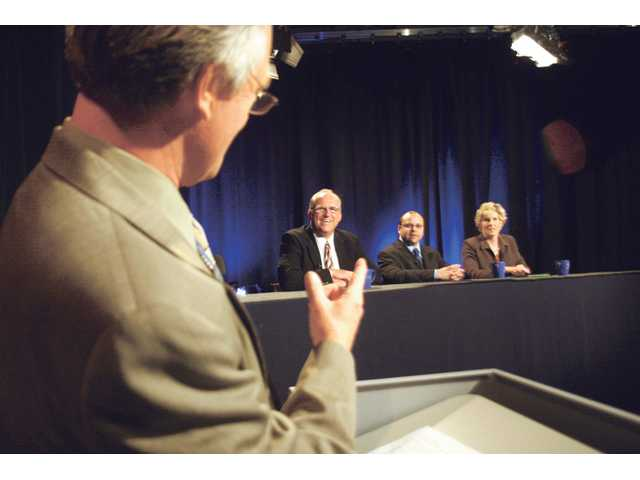 Moderator Leon Worden, left, gives instructions to Newhall County Water District candidates, from left to right, B.J. Atkins, Michael Cruz and Maria Gutzeit before a debate Wednesday afternoon. The debate was hosted by SCVTV, KHTS AM-1220 Radio and The Signal newspaper.