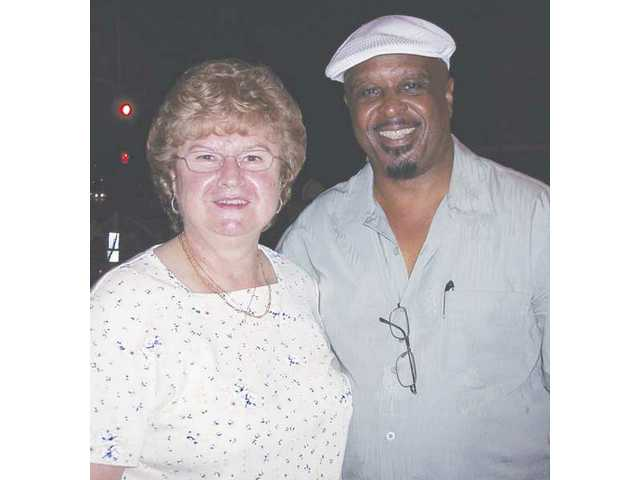 Morris Thomas, circulation director of The Signal (right) with Donna Bennett winner of The Signal's raffle prize awarded at the last Jazz and Blues concert of 2008. Bennett received a golf package to the Tournament Players Club in Valencia.
