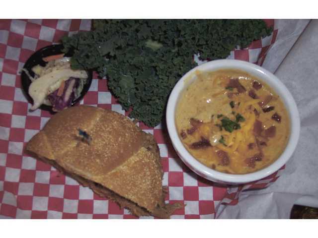 T-Bo's House of BBQ in Canyon Country offers a $9.99 lunch special that includes one half a sandwich, fries and a soda. You can also substitute soup. Shown above, T-Bo's signature coleslaw, North Carolina Pulled Pork sandwich and loaded baked potato soup.