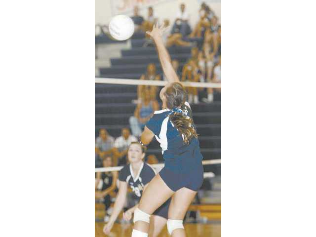West Ranch outside hitter Kayley Braucher serves. The Wildcats won in three straight sets.