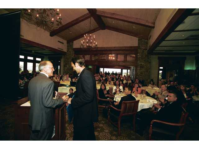 "Bill Kennedy, chairman of the Santa Clarita Valley Chamber of Commerce board, presents state Assemblyman Cameron Smyth with an award recognizing the politician as one of Santa Clarita Valley's ""40 under 40,"" on Thursday at the Tournament Players Club in Valencia. More than 60 people were nominated for awards."
