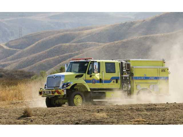 An all-wheel-drive Type III fire engine gets taken for a test drive, Tuesday afternoon at the Del Valle fire training facility near Castaic.