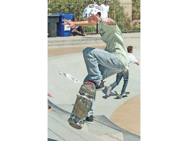 "Kevin Conway, 16, attempts to complete the ""step up"" portion of the Wild in the Parks competition in the 15-and-over category at Santa Clarita Skate Park on Saturday."