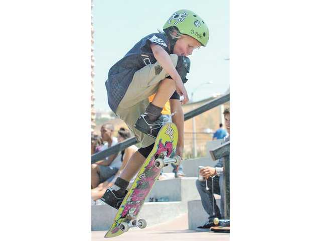 Sebastian Kuhr competes in the 14-and-under group at Wild in the Park at Santa Clarita Skate Park on Saturday.