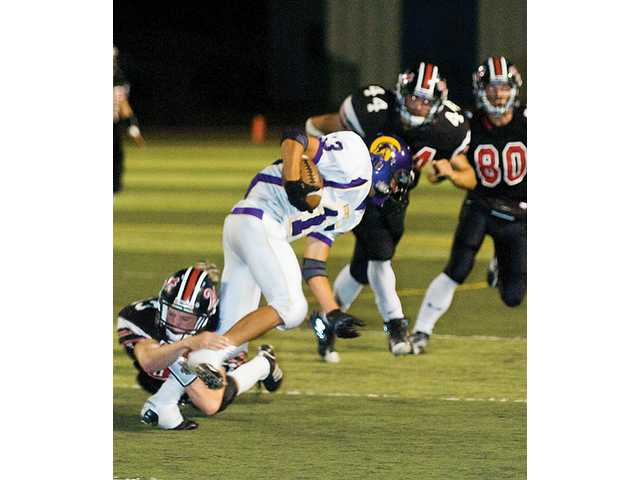 Hart's Ty MacArthur brings down a Righetti runner during first half action.