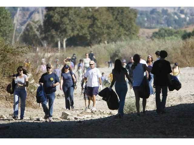 About 1,500 volunteers or all ages turned out to the 14th River Rally event Saturday morning. Members of the community helped clean part of the Santa Clara River from 8 to 11am.