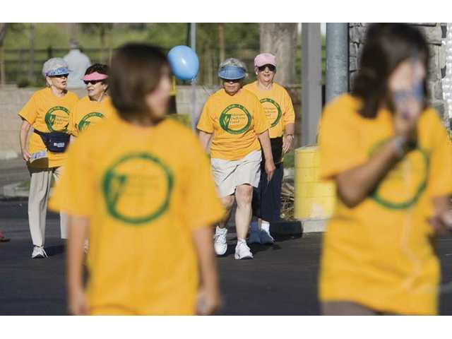 Participants make their way back from a nearly 2-mile walk on Saturday morning in Valencia. The event benefited the Hunger Defense Fund and wanted to bring awareness to the services provided by the program to alleviate hunger in the community.