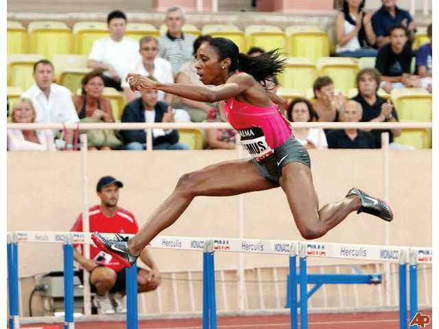 United States hurdler Lashinda Demus competes at the Herculis International Athletics Meeting at the Louis II Stadium on July 28 in Monaco, France. Demus, a hurdles coach at College of the Canyons, has returned to top form following the birth of her twins.