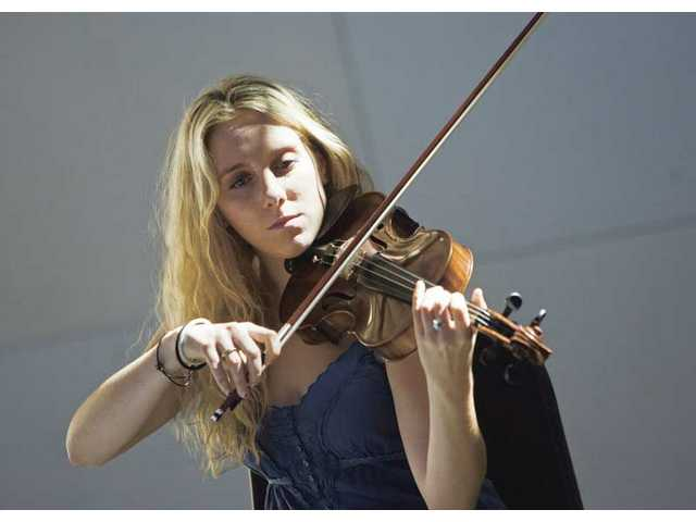 Alessandra Barrett plays her violin during a string workshop inside The Wild Beast at the California Institute of the Arts campus in Valencia on Tuesday.