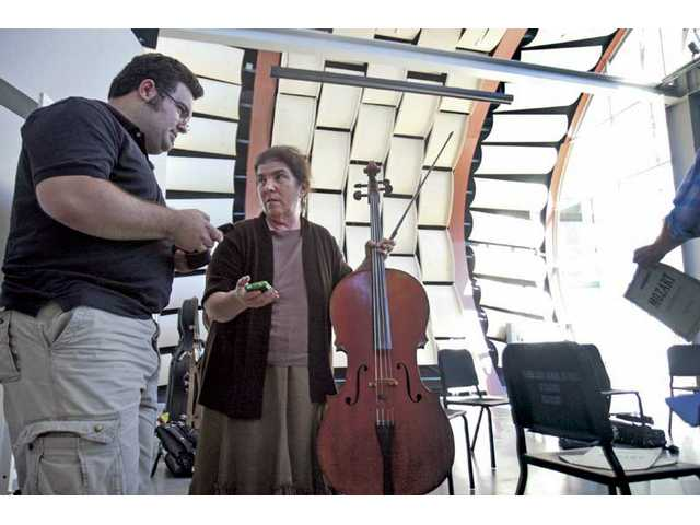 Professor Erika Duke-Kirkpatrick, right, talks with student Derek Stein during a break. The Valencia art school finished the $4 million shape-shifting, multi-use music pavilion over the summer.
