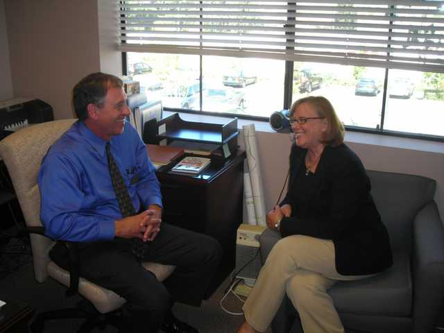 New Child & Family Center CEO Darrell Paulk, left, discusses plans with Lois Bauccio, president of the center's foundation.