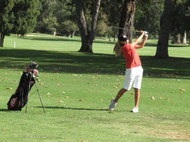 Hart's Brenna Carlson watches her shot Tuesday at Encino Golf Course. She finished at 3-under.