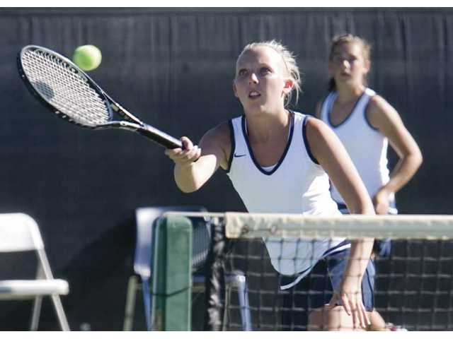 West Ranch's Mallory Martin reaches for the ball as her doubles teammate True O'Neill watches in the duo's win over Saugus' No. 1 doubles team.