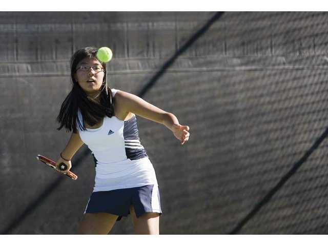 Saugus High's Yumi Suh prepares to hit a forehand in a match against West Ranch's Lena Poonnopatam on Tuesday.