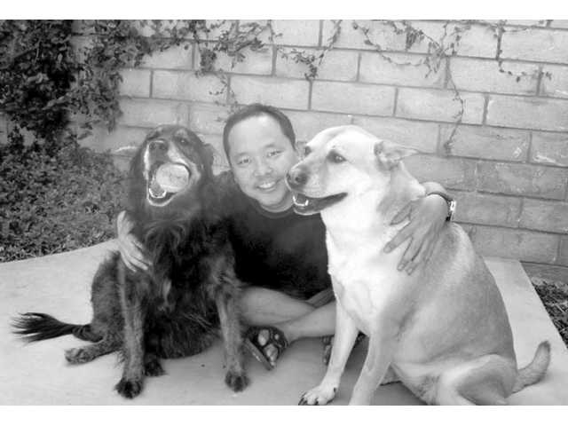 Comedian Paul Ogata is shown with his rescued dogs, Nyla and Coffee Bean.