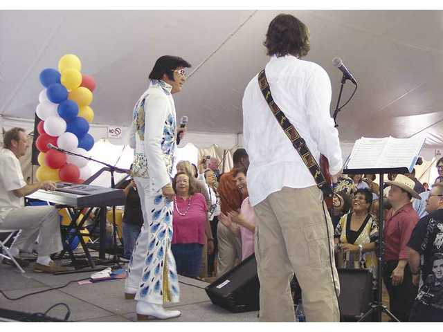 "Raymond Michael as ""Elvis"" (center) sings for the adoring residents of LARC Ranch in Saugus. Rick Cowling (right) and Mark LeVang (left) performed in the band."