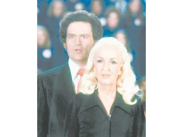 This undated file photo made available by Tony Alamo Christian Ministries shows Tony Alamo and his wife Susan. The FBI says evangelist Tony Alamo has been arrested in Arizona on suspicion of transporting minors across state lines for sexual purposes.