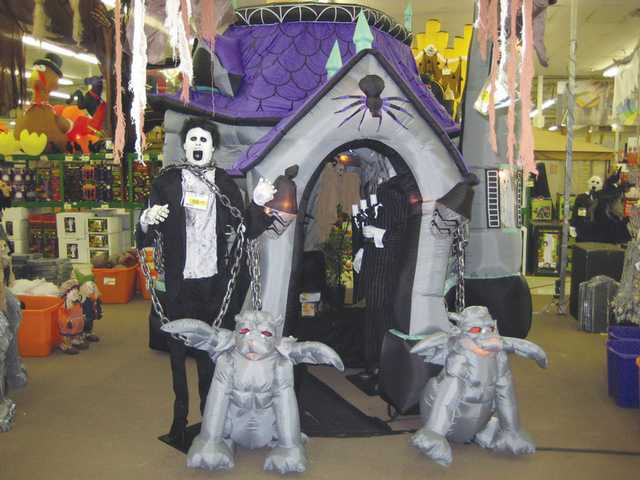 Inflatable haunted houses are a popular outdoor decoration at homes during Halloween.