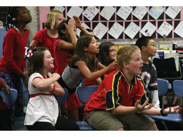 "Fifth- and sixth graders from Golden Oak Community School react as a teammate misses an answer during a classroom demonstration including ""Are you smarter than a 5th/6th grader?"" contest between students and adult dignitaries on Friday morning."