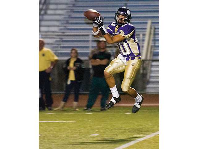 Valencia's Zack Tartabull grabs a second quarter pass that led to the Vikings' first touchdown.