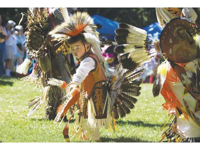 Samuel Sierra, 3, of Canyon Country, represents the Tigua tribe from El Paso, Texas, as he dances during the 15th Annual American Powwow celebration in Newhall on Saturday.