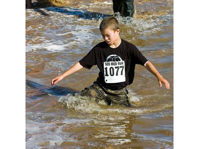 Miguel Bagues, 11, was the first kid to finish the Mud Run Sunday at Pitchess Detention Center.