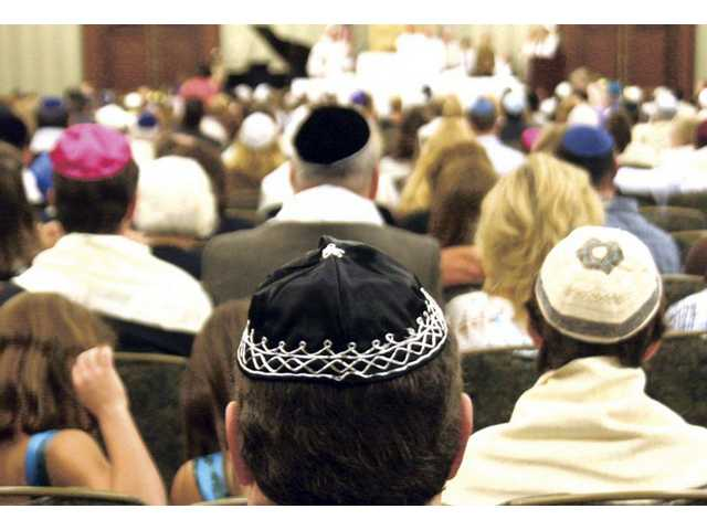 Hundreds of local Jews gathered at the Hyatt Regency Valencia to worship for Yom Kippur on Monday morning. One of the holiest days in the religion, Jews fast for 25 hours and pray most of the day at the synagogue.