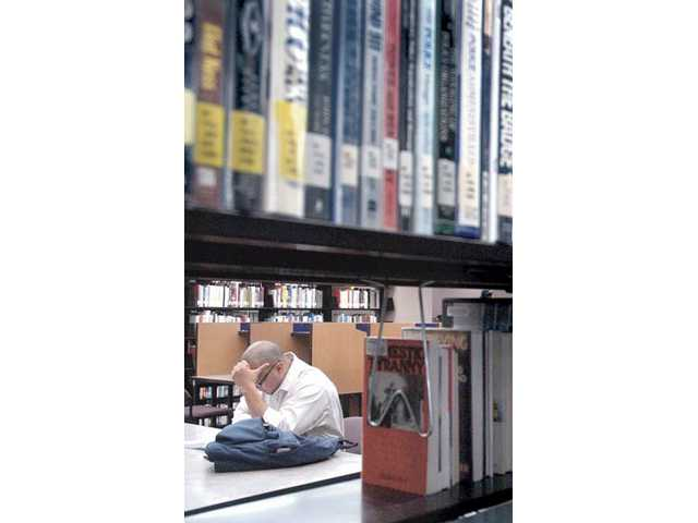 A student studies at the College of the Canyons library on Tuesday. The college is looking to start a $24 million dollar expansion project next spring.