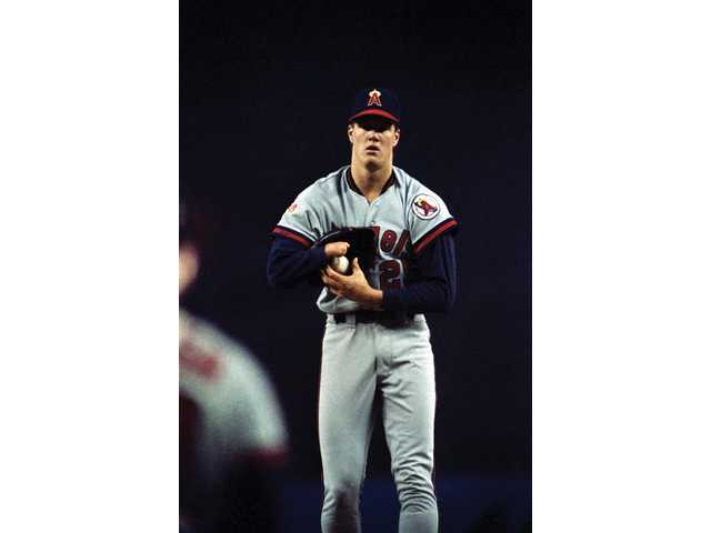 Angels pitcher Jim Abbott transfers the ball from his glove as he gets ready to pitch at Yankee Stadium on May 24, 1989, New York.
