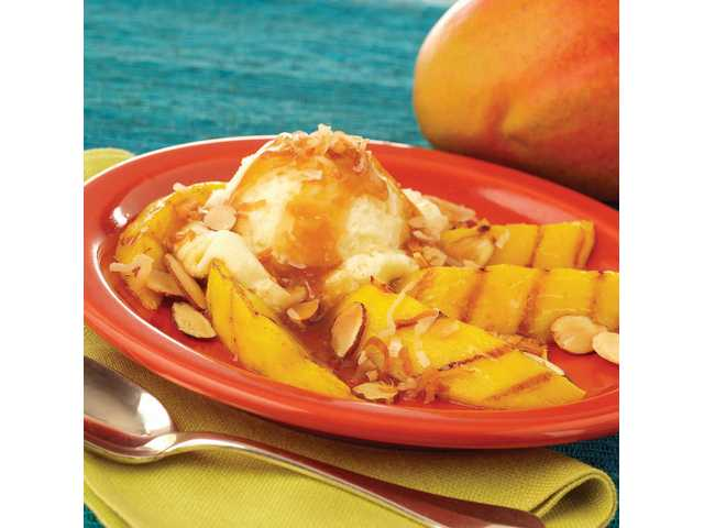 Grilled Mango With Spicy Rum Glaze and Vanilla Ice Cream