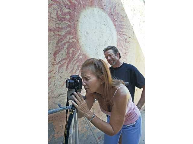 Robin Shane, left, and her husband Mike made a day trip to the Placerita Nature Center to shoot pictures for a photo assignment in her black and white photography class at College of the Canyons.