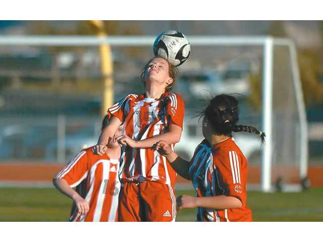 Hart High soccer's Megan Indermill (15) goes upfor a header Jan. 15. Hart plays Quartz Hill Wednesday.